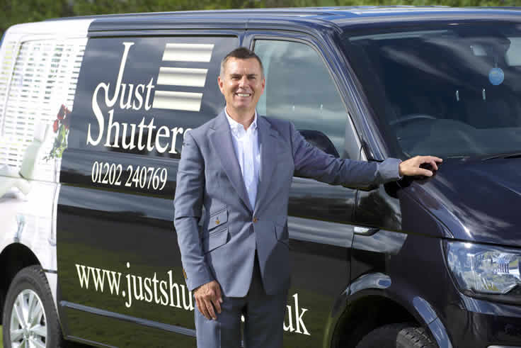Man with Just shutters van
